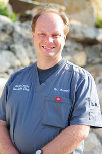 Dr. John E. Russell, D.V.M. - Our Veterinarian